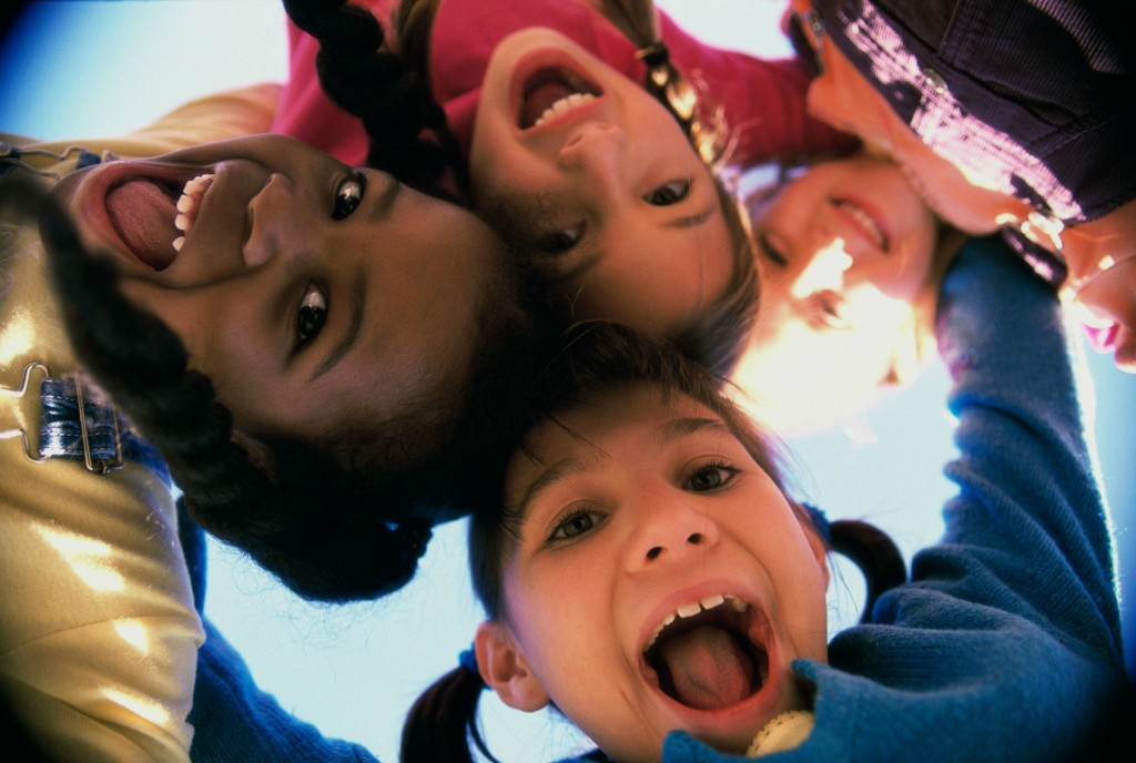 smiling children looking down at the camera