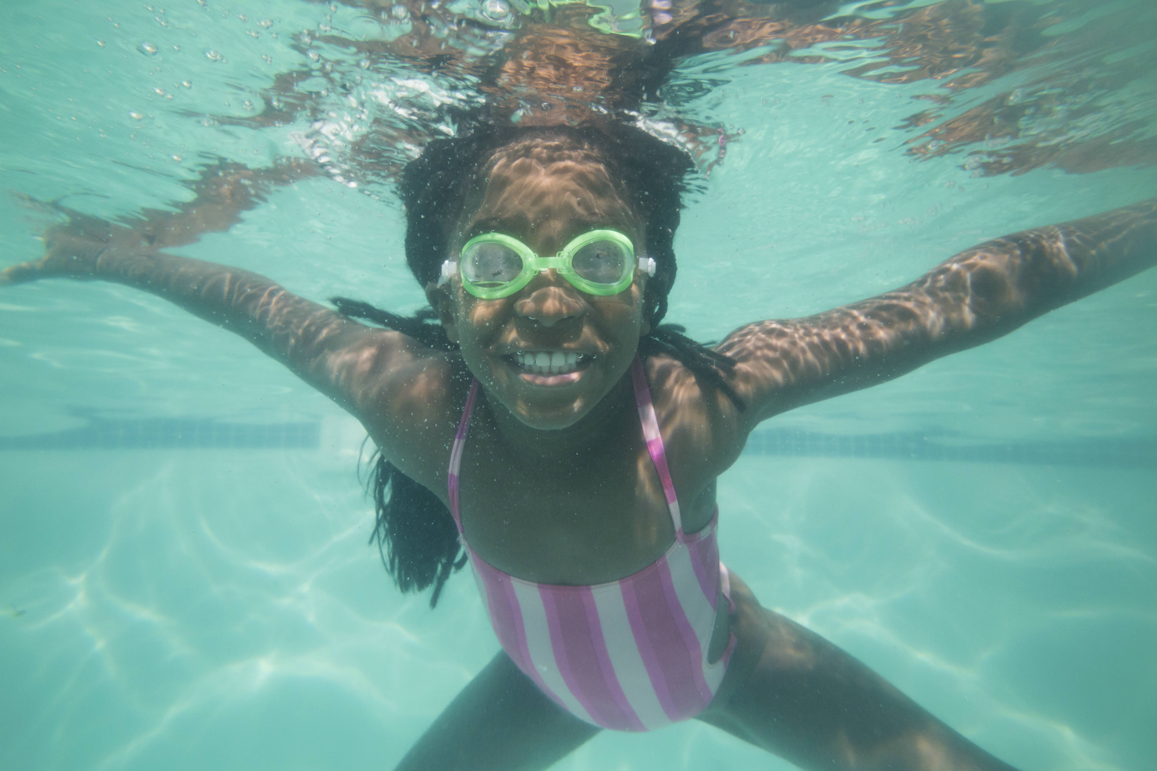child swimming under the water