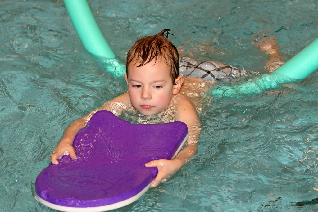 child swimming with float-web
