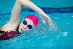 girl swimming front crawl